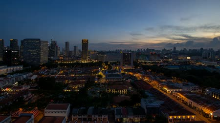 Time lapse movie of sunset to blue hour over Kampong Glam with Singapore Urban cityscape. Kampong Glam is a Malay village where the Sultan Mosque and Malay Heritage Center are located 1920x1080 Стоковые видеозаписи