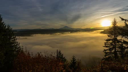 mt : Time Lapse Movie of Moving Fog and Low Clouds with Snow Covered Mt. Hood One Early Morning at Sunrise 1920x1080 Stock Footage