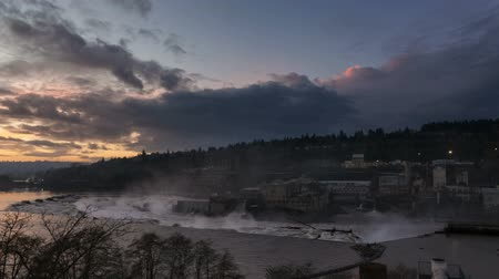 sustentável : Time-lapse movie of Colorful Sunset with Dramatic Cloud Movement over Willamette Falls and Hydro Power Plant in Oregon 1920x1080 Stock Footage