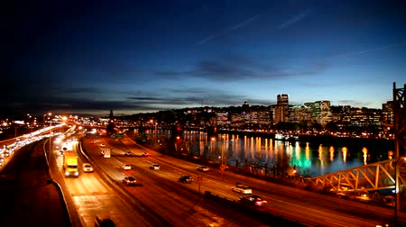 Panning Movie of Downtown City Skyline in Portland Oregon along Willamette River with Peak Hour Freeway Traffic and Blue Hour Water Reflection at Night 1920x1080