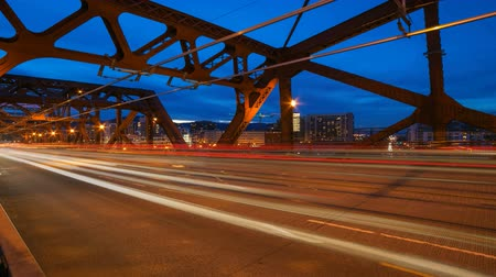 north america : Time Lapse Movie of Long Exposure Light Trails During Peak Hour Road Traffic on Broadway Bridge from Daylight into Blue Hour in Portland Oregon 1920x1080