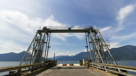 bílé mraky : Time Lapse of White Clouds and Blue Sky Over Ferry Dock at Porteau Cove Provincial Park in Vancouver British Columbia 1920x1080