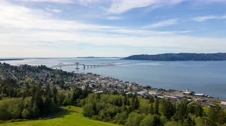 homes : Time Lapse Movie of Moving Clouds and Blue Sky over Coastal town of Astoria Oregon with AstoriaMegler Bridge Connecting to Washington State at the Mouth of Columbia River along Pacific Ocean 1080p
