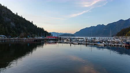 podkowa : Ultra High Definition UHD 4k Time Lapse Movie of Moving Clouds with Water Reflection at Sunset in Horseshoe Bay BC British Columbia Canada 4096x2304