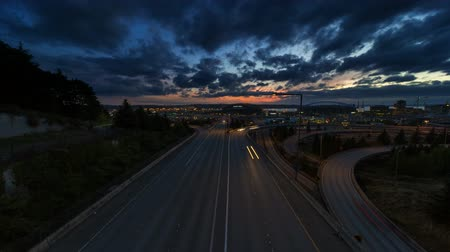 north america : Ultra High Definition UHD 4k Time Lapse Movie of Long Exposure Freeway Traffic and Moving Clouds Over Cityscape of Seattle Washington at Sunset into Blue Hour 4096x2304
