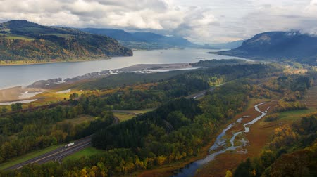 ravina : Ultra High Definition 4k Time Lapse Movie of Thick Moving White Clouds over Columbia River Gorge and Highway 84 Freeway Traffic in Early Fall Season Portland Oregon 4096x2304