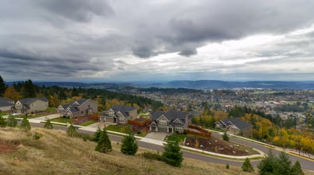 homes : Ultra High Definition 4k Time Lapse Movie of Stormy Clouds and Sky Over Residential Homes in Happy Valley Oregon in Colorful Autumn Fall Season 4096x2304
