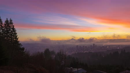 barışçı : UHD Time Laspe movie of thick rolling fog and low clouds over city of downtown Portland Oregon and snow covered mt. hood one early morning at colorful sunrise during winter season 4096x2304