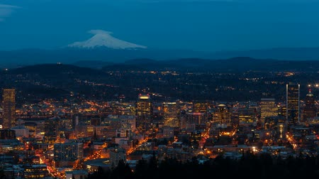 usa : UHD 4k time lapse of auto traffic and light trails over snow covered Mt. Hood and city of Portland Oregon from daylight into blue hour