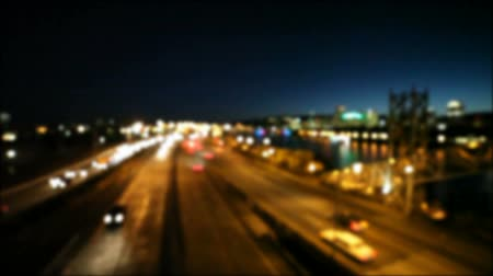 High definition 1080p out of focus movie of moving freeway traffic in downtown Portland Oregon at night bokeh HD
