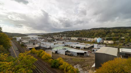 Time lapse movie of fast moving clouds over Willamette Falls Paper Mill in Oregon City one fall day in autumn season 4k ultra high definition 4096x2304