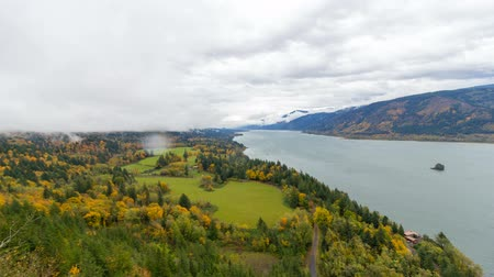 Ultra high definition 4k time lapse movie of moving clouds and sky over Cape Horn in Washington State along scenic Columbia River Gorge during colorful fall autumn season 4096x2304