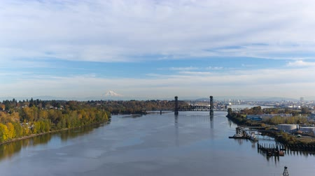 Time lapse movie of of moving clouds over industrial area with steel bridge and downtown Portland OR along Willamette River in colorful autumn fall season 4k uhd Стоковые видеозаписи