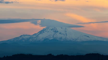 Time lapse movie of moving clouds over Mt. Hood in Happy Valley OR 4k Uhd