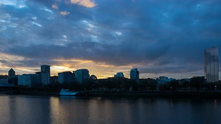 Ultra high  definition 4k time lapse movie of clouds and auto traffic along Willamette River waterfront in downtown Portland Oregon at colorful sunset 4k uhd 4096x2304