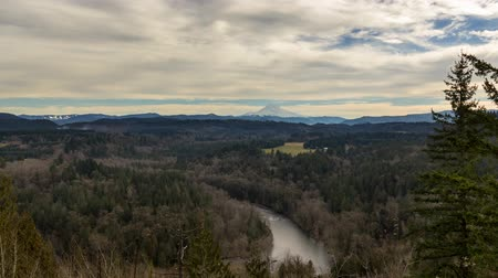 Ultra high definition 4k time lapse movie of clouds and sky over the expansive view of Sandy River and snow covered Mt. Hood from Jonsrud viewpoint in Oregon one winter day at sunset 4096x2304 uhd