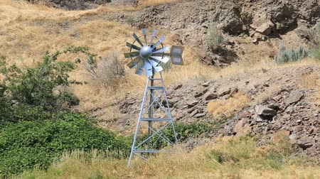 High definition 1080p video of moving windmill aerator structure in high desert in central Oregon