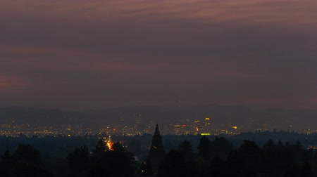 Ultra high definition 4k time lapse movie of Portland OR downtown cityscape hazy conditions from forest fires at sunset Стоковые видеозаписи
