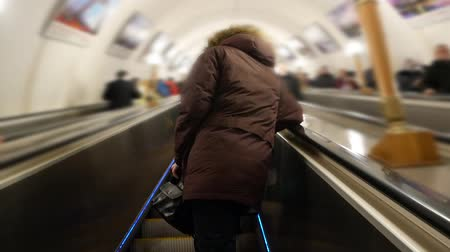 a man is riding an escalator in the subway, going to work Dostupné videozáznamy