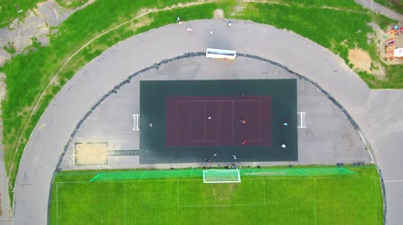 Aerial View From Drone Soccer game from above in a sunny day at small field