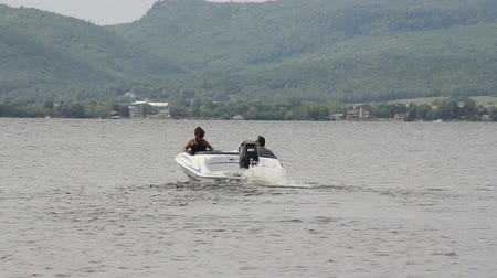 mature couple riding on motor boat