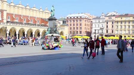 lengyelország : Main Market square with tourists in Krakow Poland footage