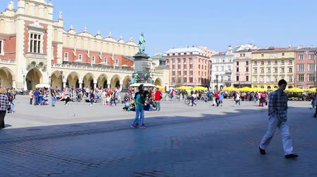 sukiennice : Main Market square with tourists in Krakow Poland footage