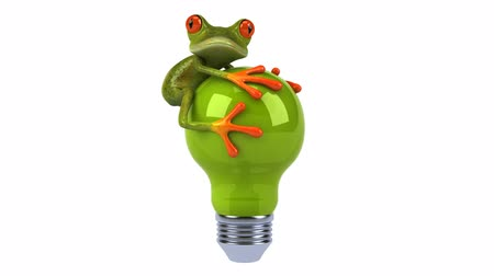 мультфильмы : green springer frog on a light bulb Стоковые видеозаписи