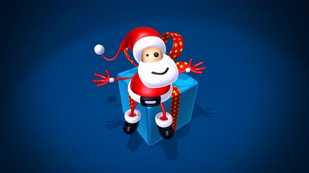 posta kutusu : santa sitting on a gift over dark background Stok Video