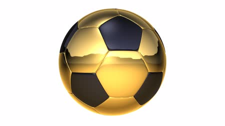 jogador de futebol : golden rotating soccer ball over white background Stock Footage