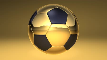 jogadores : golden rotating soccer ball over yellow background