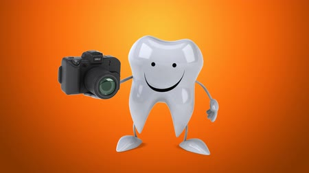 cálcio : Cartoon tooth character with a camera