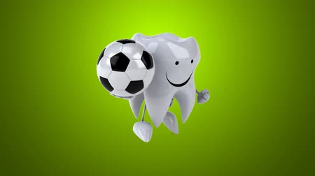 Cartoon tooth character with soccer ball