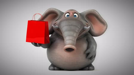 vadon : Cartoon elephant with shopping bag Stock mozgókép