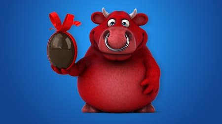 bull ring : Cartoon red bull with chocolate Easter egg Stock Footage