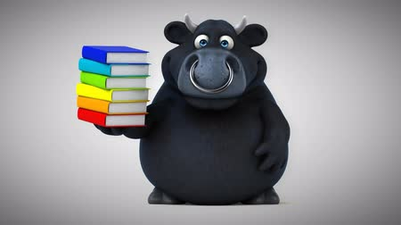bull ring : Cartoon black bull with stack of books