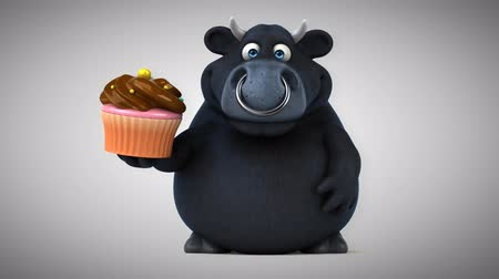 bull ring : Cartoon black bull with cupcake Stock Footage