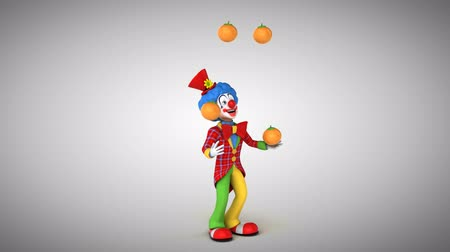 tréfacsináló : Cartoon clown juggling oranges Stock mozgókép
