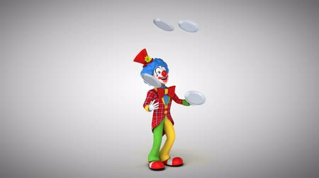 coringa : Cartoon clown juggling with empty plates Stock Footage