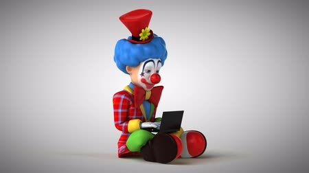 coringa : Cartoon clown with a laptop