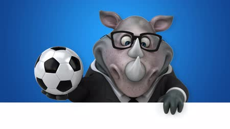 nosorožec : Cartoon rhino holding a soccer ball