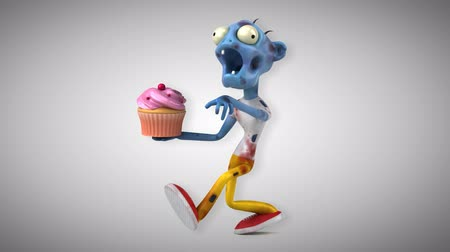 hátborzongató : Cartoon zombie with cupcake Stock mozgókép