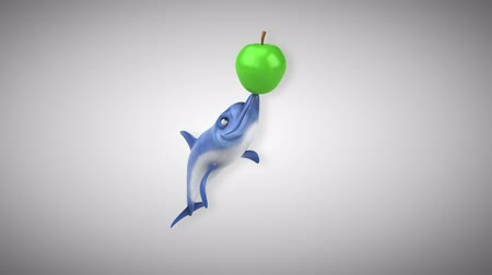 flippers : Cartoon dolphin playing with an apple Stock Footage