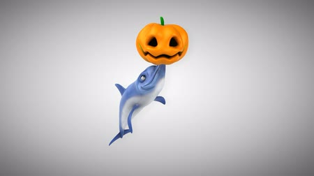 flippers : Cartoon dolphin playing with a pumpkin