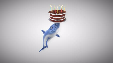 flippers : Cartoon dolphin playing with a birthday cake Stock Footage
