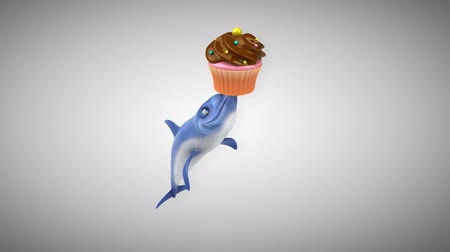 flippers : Cartoon dolphin playing with a cupcake