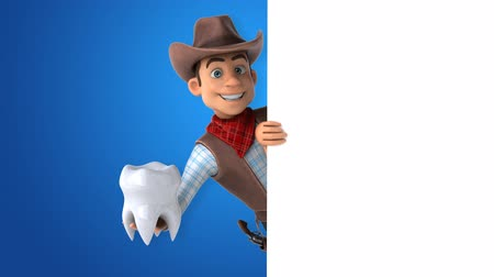 kalcium : Cartoon cowboy character with a tooth Stock mozgókép