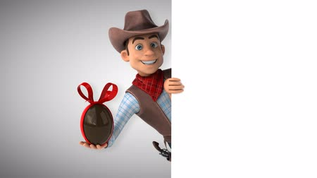 Cartoon cowboy character with chocolate egg