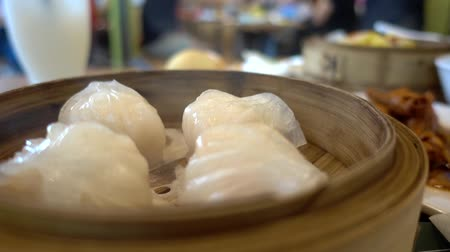 dimsum : Fresh Chinese white dimsum dumpling with steams in bamboo bowl
