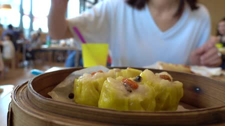 dimsum : Fresh Chinese Yellow dimsum dumpling with steams in bamboo bowl